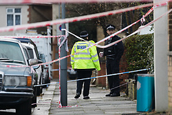 © Licensed to London News Pictures. 04/01/2018. London, UK. Police officers at the scene in Norfolk Road, Ilford, east London. Police were called last night following reports of an unresponsive woman in the street with stab injuries. She was pronounced dead at the scene at 19:16hrs. Photo credit: Vickie Flores/LNP