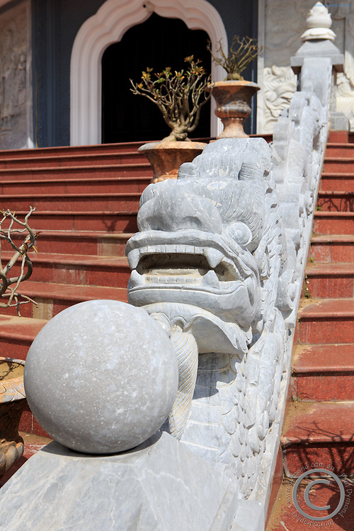 A serpent statue on the steps of the Lady Buddha in Da Nang, Vietnam