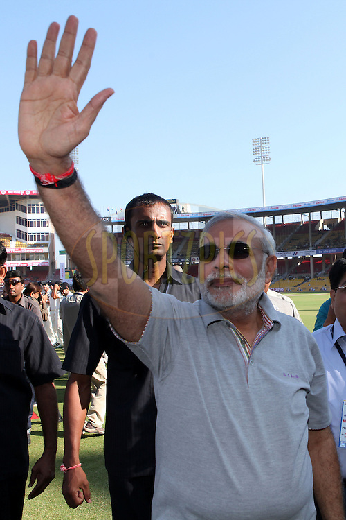 Narendar Modi (Chief Minister of Gujarat) waves to the crowd during day 1 of the first test match between India and New Zealand  held at the Sardar Patel Gujarat Stadium in Ahmedabad on the 4th November 2010..Photo by Ron Gaunt/BCCI/SPORTZPICS