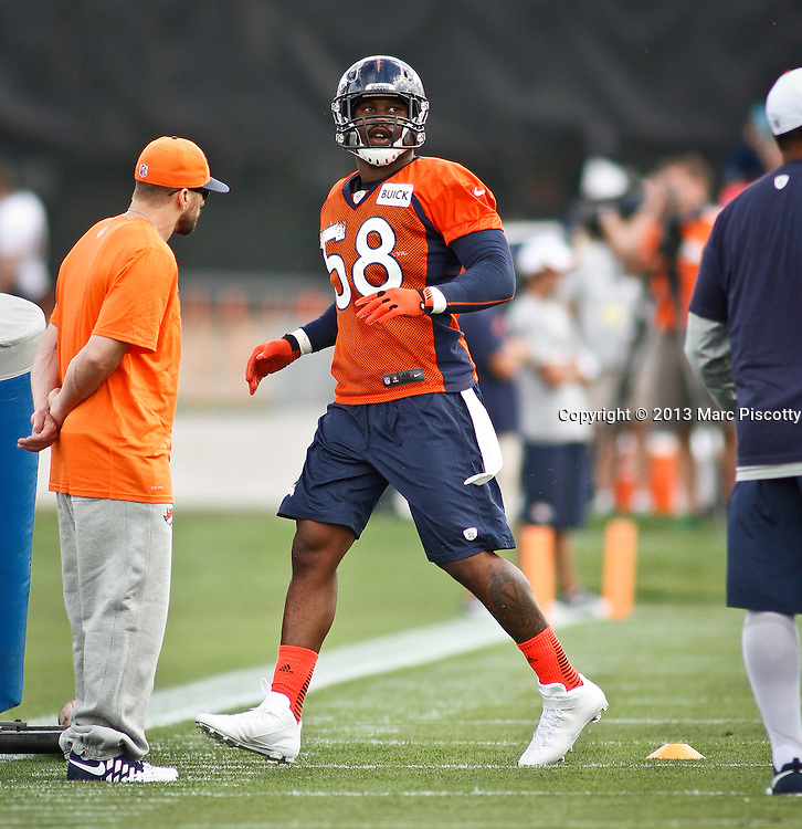 SHOT 7/25/13 9:30:06 AM - Denver Broncos linebacker Von Miller #58 runs through drills during opening day of the team's training camp July 25, 2013 at Dove Valley in Englewood, Co. Miller is appealing a possible four game suspension with the league. (Photo by Marc Piscotty / © 2013)