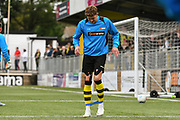 Callum Howe of Harrogate Town (5) warming up during the Vanarama National League match between Harrogate Town and Leyton Orient at Wetherby Road, Harrogate, United Kingdom on 22 September 2018.