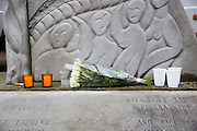 Brussels 23 March 2016 flowers and candles at the monument near the schuman square roundabout