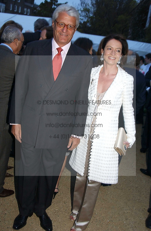 DR &amp; MRS GERT RUDOLPH FLICK he is the German multi-millionaire at the Cartier Chelsea Flower Show dinat the annual Cartier Flower Show Diner held at The Physics Garden, Chelsea, London on 23rd May 2005.<br />