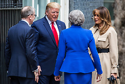 London, UK. 4 June, 2019. US President Donald Trump and First Lady Melania Trump are greeted by Prime Minister Theresa May and her husband Philip May as they arrive in Downing Street to meet Prime Minister Theresa May on the second day of his state visit to the UK.