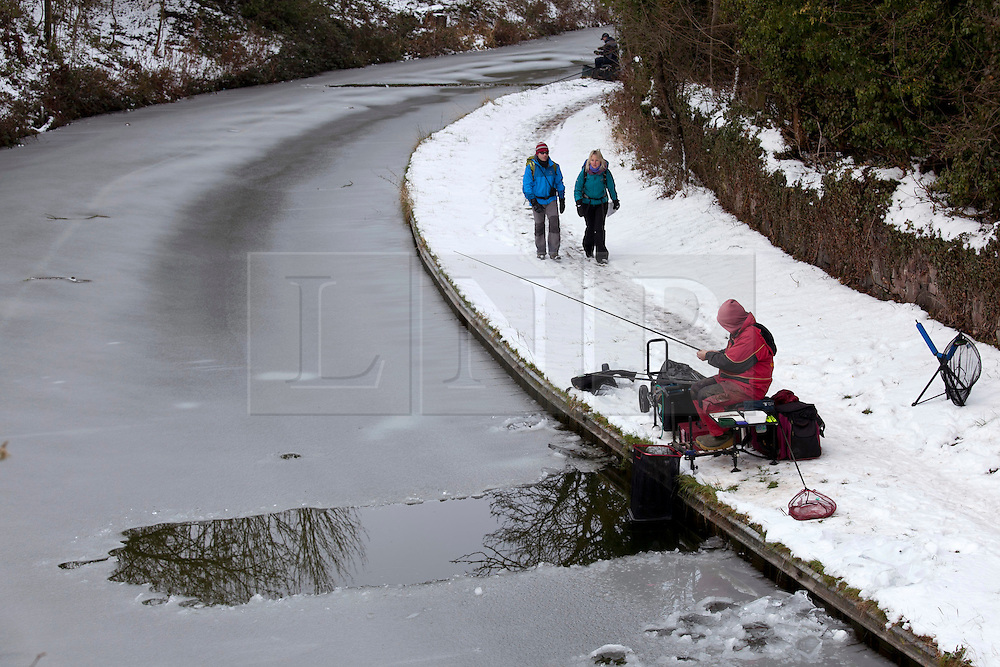 © Licensed to London News Pictures. 05/02/2012, Nuneaton, Warwickshire, UK. Fishermen brave the elements to fish in the Coventry Canal in Nuneaton, Warwickshire earlier today. Photo credit : Dave Warren/LNP