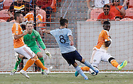Jun 29, 2016; Houston, TX, USA; Houston Dynamo midfielder Collen Warner (26) blocks Sporting Kansas City midfielder Graham Zusi (8) shot in the second half at BBVA Compass Stadium. Dynamo won 3 to 1. Mandatory Credit: Thomas B. Shea-USA TODAY Sports