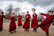 UNITED KINGDOM, Winchester: 05 March 2019 Winchester Pancake Race Photo Feature:<br /> Members belonging to the Winchester Cathedral Choir enjoy playing after competing in the Inaugural Winchester Pancake Race earlier this afternoon on Shrove Tuesday. The race, which consisted of 20 teams, took place in the gardens surrounding Winchester Cathedral. <br /> Rick Findler / Story Picture Agency