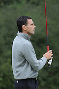 Gus Poyet watches his first tee shot during the Julian Speroni Testimonial Golf Day at the Surrey National Golf Club, Chaldon, United Kingdom on 9 September 2015. Photo by Michael Hulf.