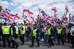 Luton, UK. 27th June, 2015. Supporters of far-right group Britain First take part in a march through Luton. Police failed to prevent Paul Golding and Jayda Fransen, leader and deputy leader of Britain First, from attending the march, but ensured that they could not carry banners demanding no more mosques. A counter-protest was organised by Unite Against Fascism.