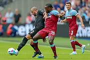 Manchester City defender Kyle Walker (2) battles for possession West Ham United midfielder Michail Antonio (30) during the Premier League match between West Ham United and Manchester City at the London Stadium, London, England on 10 August 2019.