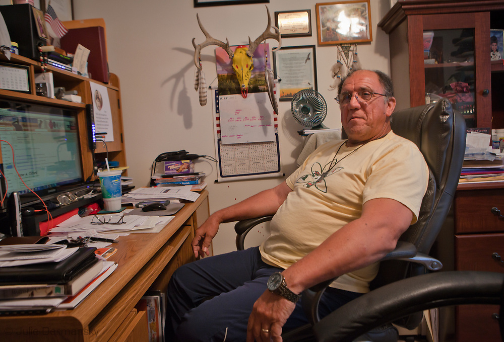 Chief Albert P. Naquin of Isle de Jean Charles Band of Biloxi-Chitimacha-Choctaw indians at his desk in Montegut , Louisiana. Chieff Naquin does what he can for his tribe to protect them from losing their culture as memebers leave the area due to rising tides.