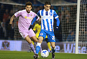Brighton striker Anthony Knockaert shields the ball from Reading midfielder Daniel Williams during the Sky Bet Championship match between Brighton and Hove Albion and Reading at the American Express Community Stadium, Brighton and Hove, England on 15 March 2016. Photo by Bennett Dean.