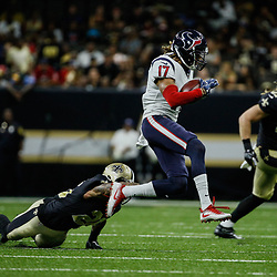 Aug 26, 2017; New Orleans, LA, USA; Houston Texans wide receiver Dres Anderson (17) escapes a tackle attempt by New Orleans Saints cornerback Marshon Lattimore (23) during the second quarter of a preseason game at the Mercedes-Benz Superdome. Mandatory Credit: Derick E. Hingle-USA TODAY Sports