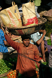 BANGLADESH DHAKA KAWRAN BAZAAR 2MARB05 - Market scenes at Kawran Bazaar vegetable market. The Bazaar has been in the Tejgaon area for at least 30 years and is one of the largest markets in Dhaka city.....jre/Photo by Jiri Rezac....© Jiri Rezac 2005....Contact: +44 (0) 7050 110 417..Mobile:  +44 (0) 7801 337 683..Office:  +44 (0) 20 8968 9635....Email:   jiri@jirirezac.com..Web:    www.jirirezac.com....© All images Jiri Rezac 2005- All rights reserved.