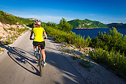 Cyclist above the Adriatic, Ston, Dalmatian Coast, Croatia