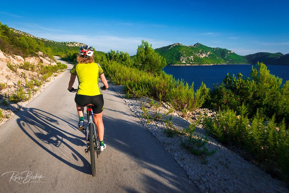 Cyclist above the Adriatic, Ston, Dalmatian Coast, Croatia