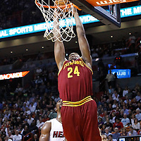 24 January 2012: Cleveland Cavaliers power forward Samardo Samuels (24) dunks the ball past Miami Heat power forward Chris Bosh (1) during the Miami Heat 92-85 victory over the Cleveland Cavaliers at the AmericanAirlines Arena, Miami, Florida, USA.