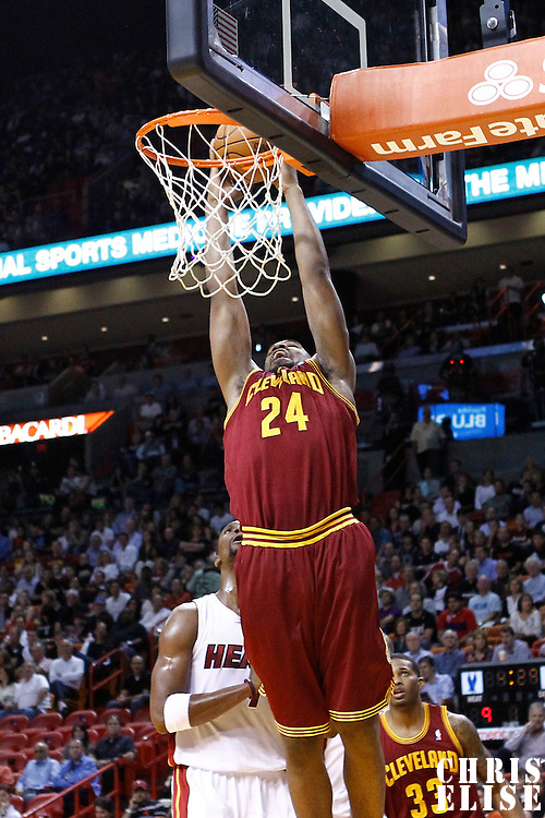 24 January 2012: Cleveland Cavaliers power forward Samardo Samuels (24) dunks the ball past Miami Heat power forward Chris Bosh (1) during the Miami Heat 92-85 victory over the Cleveland Cavaliers at the AmericanAirlines Arena, Miami, Florida, USA.