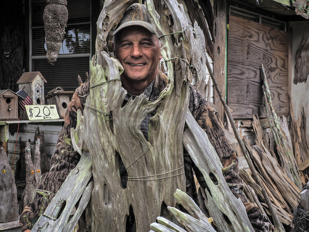 Adam Morales, folk artist in Pierre Part, Louisiana posing at his musuem,  Adam's Cypress Swamp Driftwood Family Museum.