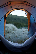 Wake up view from within the tent, alongside Green Lake, Fiordland.