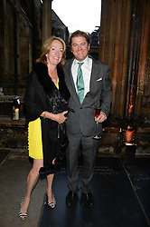 """LADY ALEXANDRA ETHERINGTON and RUPERT LUND at a private view to view """"The Coronation Theatre: Portrait of Her Majesty Queen Elizabeth II"""" painted by Ralph Heimans held at Westminster Abbey, London on 12th September 2013."""