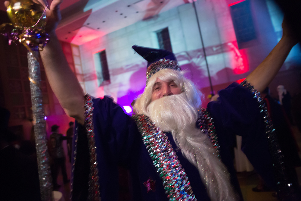 A man costumed as a bejeweled wizard.