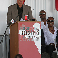 Inductee and announcer Michael Buffer gives his induction speech during the 23rd Annual International Boxing Hall of Fame Induction ceremony at the International Boxing Hall of Fame on Sunday, June 10, 2012 in Canastota, NY. (AP Photo/Alex Menendez)