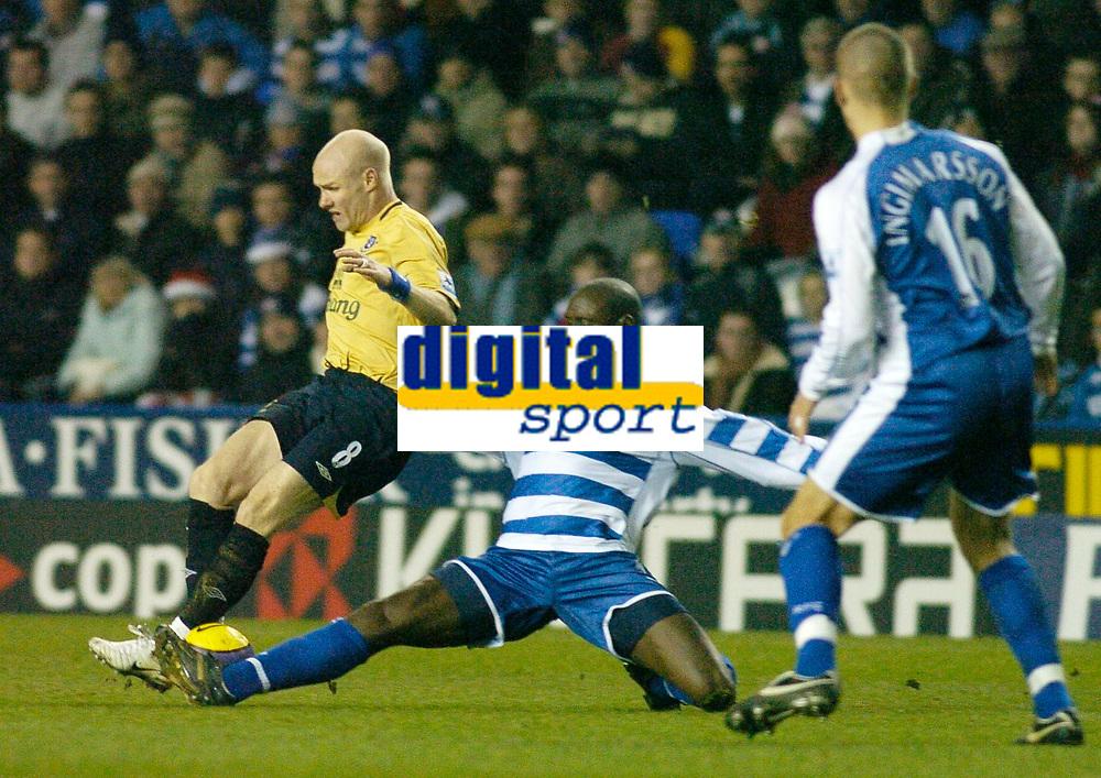 Photo: Gareth Davies.<br /> Reading v Everton. The Barclays Premiership. 23/12/2006.<br /> Reading's Ibrahima Sonko (R) slides in on Everton's Andrew Johnson (L).