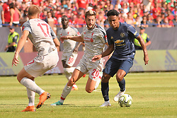 July 28, 2018 - Ann Arbor, MI, U.S. - ANN ARBOR, MI - JULY 28: Manchester United Defender Demetri Mitchell (35) dribbles past Liverpool Midfielder Adam Lallana (20) in the ICC soccer match between Manchester United FC and Liverpool FC on July 28, 2018 at Michigan Stadium in Ann Arbor, MI. (Photo by Allan Dranberg/Icon Sportswire) (Credit Image: © Allan Dranberg/Icon SMI via ZUMA Press)