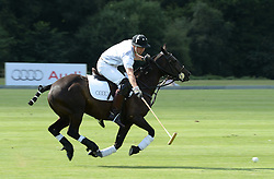 HRH THE DUKE OF CAMBRIDGE (white no 4 shirt) at the Audi Polo Challenge 2013 at Coworth Park Polo Club, Berkshire on 3rd August 2013.