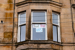 Glasgow, Scotland, UK. 3 April, 2020. Images from the south side of Glasgow at the end of the second week of Coronavirus lockdown. Pictured; hand drawn message in window of flat in Govanhill. Iain Masterton/Alamy Live News