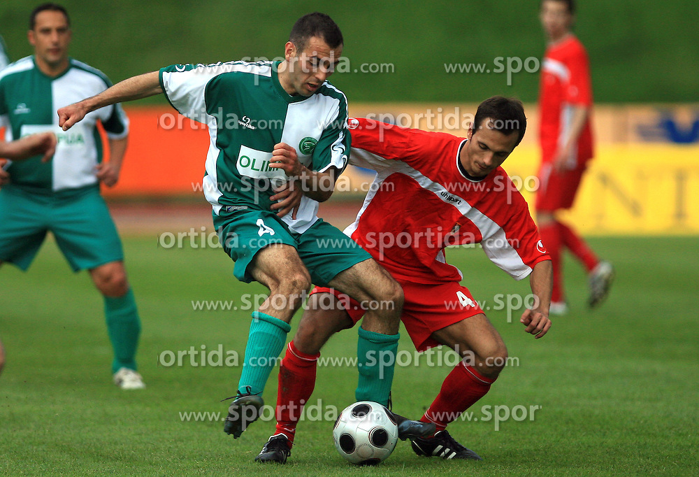 Adnan Alagic of Olimpija vs Denis Pusic of Zagorje at football match of 2nd SNL between NK Olimpija Ljubljana and NK Zagorje, on May 03, 2009, in ZAK stadium, Ljubljana, Slovenia. Olimpija won 9:0 and 4 Rounds before the end won the 1st place in 2nd SNL. Next year they will play in First Slovenian League. (Photo by Vid Ponikvar / Sportida)