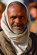 A grey haired bearded old man with his head covered, Agra, India