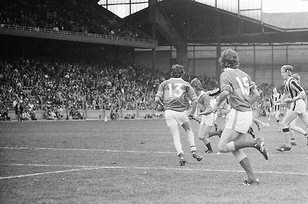 Tipperary player runs towards the goal as players wait by the goalmouth during the All Ireland Minor Hurling Final, Tipperary v Kilkenny in Croke Park on the 5th September 1976.