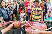 "11 JANUARY 2014 - BANGKOK, THAILAND: People look at mockups of battlefield casualties during Children's Day in Bangkok. The Royal Thai Army hosted a ""Children's Day"" event at the 2nd Cavalry King's Guard Division base in Bangkok. Children had an opportunity to look at military weapons, climb around on tanks, artillery pieces and helicopters and look at battlefield medical facilities. The Children's Day fair comes amidst political strife and concerns of a possible coup in Thailand. Earlier in the week, the Thai army announced that movements of armored vehicles through Bangkok were not in preparation of a coup, but were moving equipment into position for Children's Day.      PHOTO BY JACK KURTZ"