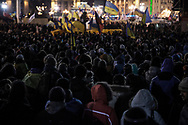 Anti-government protesters listen to speeches during a massive demonstration on Maidan Square on December 8, 2013 in Kiev, Ukraine. Thousands of people have been protesting against the government since a decision by Ukrainian president Viktor Yanukovych to suspend a trade and partnership agreement with the European Union in favor of incentives from Russia.