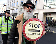A demonstrator gets his message across against fracking company Quadrilla during the Time To Act, National Climate March organised by Campaign Against Climate Change in London, England on March 7, 2015