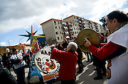 Scampia's carnival parade stops along its way to send its message to citizens and invite them to join