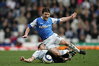 Photo: Lee Earle.<br /> Birmingham City v Chelsea. The Barclays Premiership. 01/04/2006. Chelsea's Frank Lampard (L) brings down Damien Johnson.