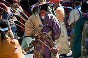 A horseback archer prepares to take part in the annual Reitaisai Grand Festival at Tsurugaoka Hachimangu Shrine in Kamakura, Japan on  14 Sept. 2012.  Sept 14 marks the first day of the 3-day Reitaisai festival, which starts early in the morning when shrine priests and officials perform a purification ritual in the ocean during a rite known as hamaorisai and limaxes with a display of yabusame horseback archery. Photographer: Robert Gilhooly