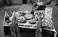 A TABLE OF FOOD, DRINKS AND PRESENTS TO BE TAKEN TO THE HOUSE OF A CHILDS GODFATHER. ROMANIAN ORTHODOX EASTER CELEBRATIONS. SINTESTI, ROMANIA, EASTER 1995..©JEREMY SUTTON-HIBBERT 2000..TEL./FAX. +44-141-649-2912..TEL. +44-7831-138817.