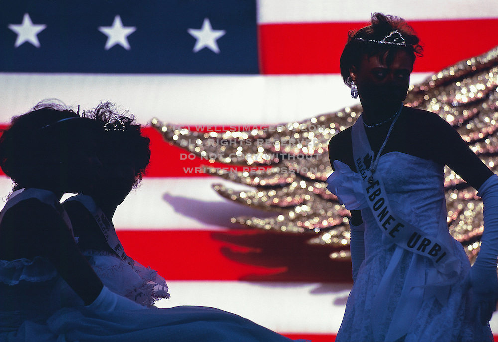 Images of America, USA, Landscape, Travel, Fine Art Photography by Randy Wells,  Seattle Seafair Parade with African American women, U.S. flag and eagle wing in background in Seattle, Washington, Pacific Northwest