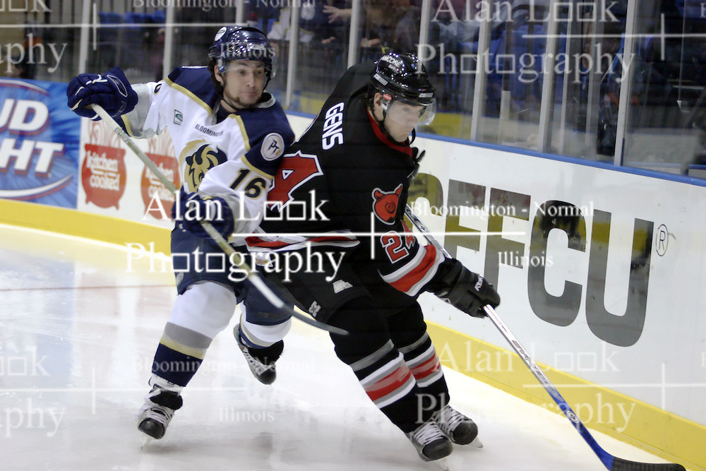 21 October 2006: Garett Cameron struggles to get around Matt Gens.  Rockford finished ahead of Bloomington 5 goals to 3. The Rockford IceHogs met the Bloomington Prairie Thunder at the U.S. Cellular Coliseum in Bloomington Illinois.<br />