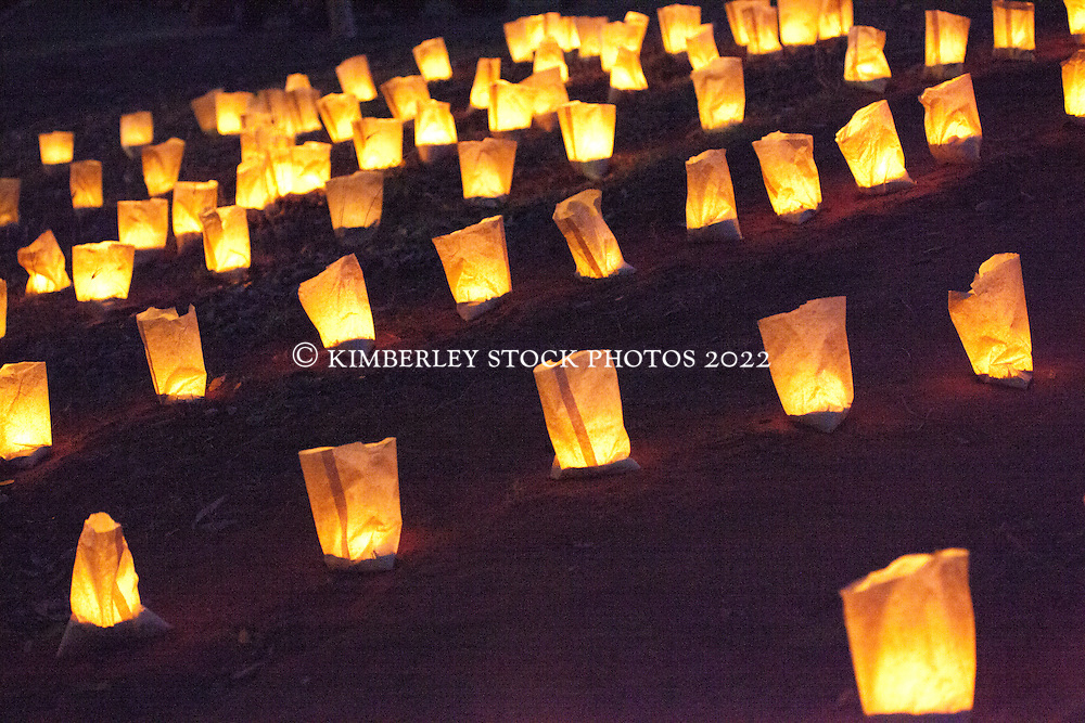 """Hundreds of candles spelling """"Faith"""" fickered in the evening light behind the Town Beach oval as thousands of concerned towns folk gather to protest the construction of an LNG hub at James Price Point on the Dampier Peninsula."""