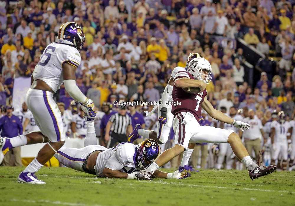 Oct 20, 2018; Baton Rouge, LA, USA; LSU Tigers defensive end Rashard Lawrence (90) tackles Mississippi State Bulldogs quarterback Nick Fitzgerald (7) during the first quarter at Tiger Stadium. Mandatory Credit: Derick E. Hingle-USA TODAY Sports