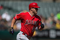 OAKLAND, CA - APRIL 13:  Mike Trout #27 of the Los Angeles Angels of Anaheim runs to first base wearing black and gold Nike Batting gloves in honor of Kobe Bryant's retirement during the first inning against the Oakland Athletics at the Coliseum on April 13, 2016 in Oakland, California. (Photo by Jason O. Watson/Getty Images) *** Local Caption *** Mike Trout