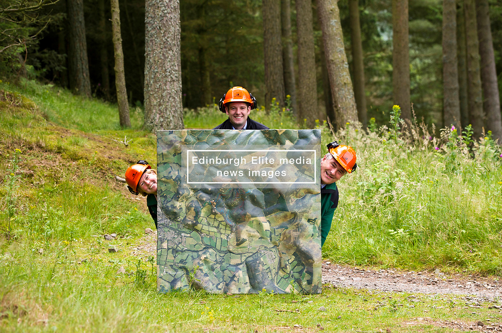 Pictured: Alan Stevenson, Foresty Enterprise Scotland, Andrew Brook, Forest Holidays (Black jacket) and Sallie Baillie, District manager Foresty Enterprise Scotland<br />  Forest Enterprise Scotland and Forest Holidays are set to join forces with proposals for the area, which could see luxury eco-cabins and new biking trails built following a multimillion-pound investment.<br /> Ger Harley   EEm 21 July  2017