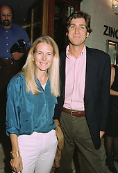 MR RUPERT & the HON.MRS SCOTT, she is the daughter of Lord Montagu,  at a party in London on 27th August 1997.MAU 34
