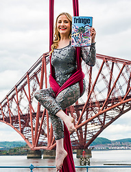 EMBARGOED TILL 10:00 5 JUNE 2019<br /> <br /> Pictured: Fringe Programme Launch. Forth Rail Bridge, South Queensferry, Scotland, United Kingdom, 04 June 2019. An aerial artist, Blaise Donald, wearing a sparkling costume performs in front of the iconic bridge launching the Edinburgh Festival Fringe programme and this year's Fringe hashtag #MakeYourFringe.<br /> <br /> Sally Anderson   EdinburghElitemedia.co.uk
