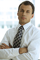 Portrait of businessman with arms crossed